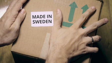 Labeling carton with MADE IN SWEDEN sticker