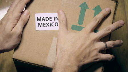 Labeling carton with MADE IN MEXICO sticker
