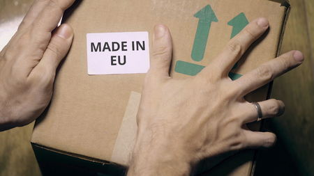 Placing sticker with MADE IN EU text on the box