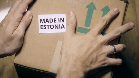Placing sticker with MADE IN ESTONIA text on the box