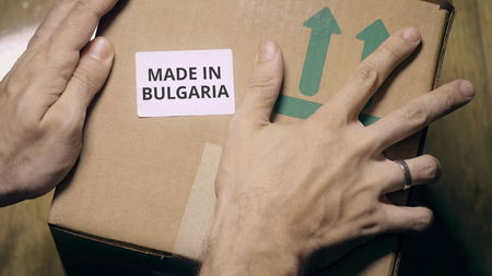 Placing sticker with MADE IN BULGARIA text on the box