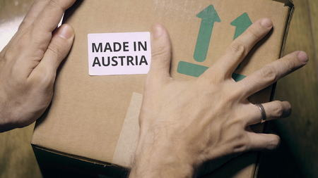 Labeling carton with MADE IN AUSTRIA sticker Stock fotó