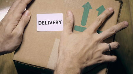 Labeling carton with DELIVERY sticker