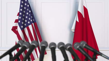 Flags of the United States and Bahrain at international meeting or negotiations press conference. 3D rendering