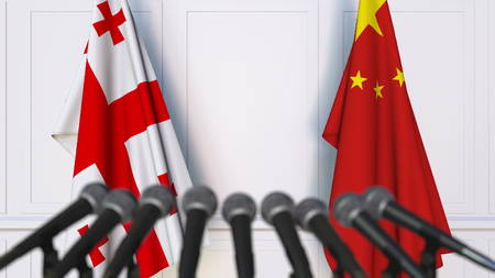Flags of Georgia and China at international meeting or negotiations press conference. 3D rendering Stock Photo