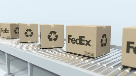 Many cartons with FEDEX logo move on roller conveyor. Editorial 3D rendering Publikacyjne