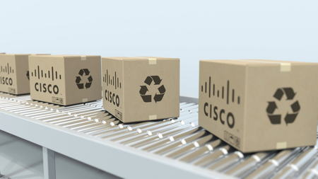 Many cartons with CISCO logo move on roller conveyor. Editorial 3D rendering