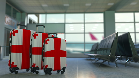 Travel suitcases with flag of Georgia. Georgian tourism conceptual 3D rendering