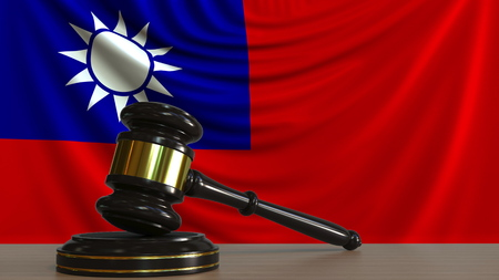 Judges gavel and block against the flag of Taiwan. Taiwanese court conceptual 3D rendering Imagens