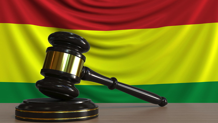 Judges gavel and block against the flag of Bolivia. Bolivian court conceptual 3D rendering