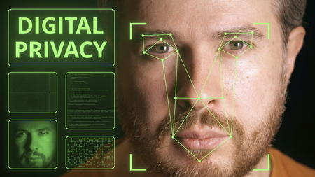 Computer system scanning face. Digital privacy related image Stock Photo