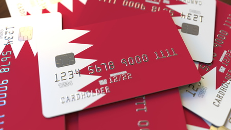 Pile of credit cards with flag of Bahrain. Bahraini banking system conceptual 3D rendering Imagens