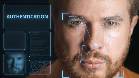 Computer system scanning face of a man. Digital authentication related image