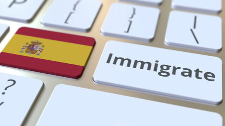 IMMIGRATE text and flag of Spain on the buttons on the computer keyboard. Conceptual 3D rendering Stockfoto