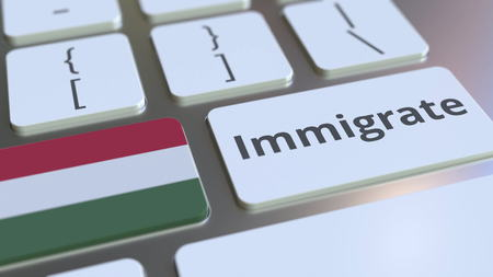 IMMIGRATE text and flag of Hungary on the buttons on the computer keyboard. Conceptual 3D rendering Banco de Imagens