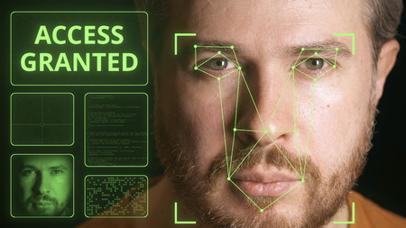 Computer system scans mans face and identifies person. Access granted
