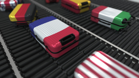 Suitcases with different state flags move on the conveyor in an airport. International tourism related 3D rendering