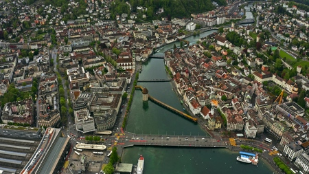 Aerial shot of Kapellbrucke or Chapel Bridge within the cityscape of Lucerne Фото со стока