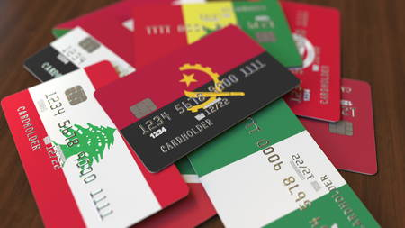 Many credit cards with different flags, emphasized bank card with flag of Angola. 3D rendering Stock fotó