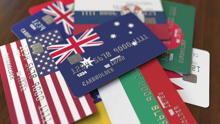 Many credit cards with different flags, emphasized bank card with flag of Australia. 3D rendering