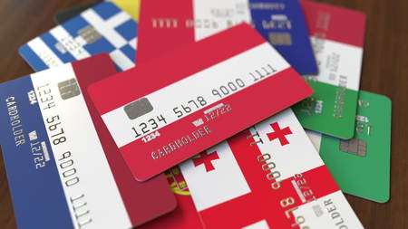 Many credit cards with different flags, emphasized bank card with flag of Austria. 3D rendering