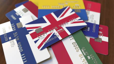 Many credit cards with different flags, emphasized bank card with flag of the United Kingdom. 3D rendering Stock fotó