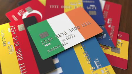 Many credit cards with different flags, emphasized bank card with flag of Ireland. 3D rendering