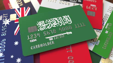Many credit cards with different flags, emphasized bank card with flag of Saudi Arabia. 3D rendering