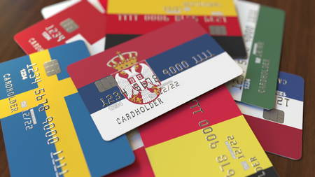 Many credit cards with different flags, emphasized bank card with flag of Serbia. 3D rendering