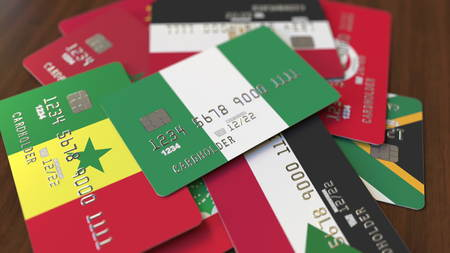 Many credit cards with different flags, emphasized bank card with flag of Nigeria. 3D rendering