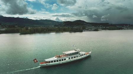 LUCERNE, SWITZERLAND - APRIL 27, 2019. Aerial shot of MS Titlis ship on the lake