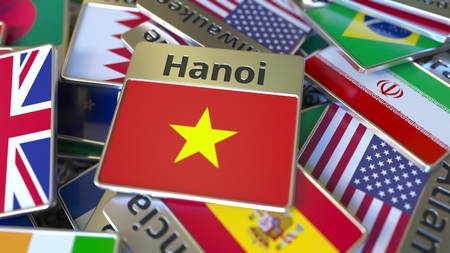 Souvenir magnet or badge with Hanoi text and national flag among different ones. Traveling to Vietnam conceptual 3D rendering