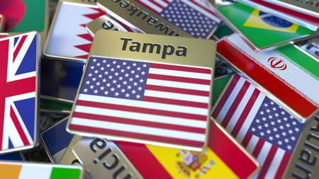 Souvenir magnet or badge with Tampa text and national flag among different ones. Traveling to the United States conceptual 3D rendering