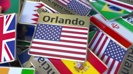 Souvenir magnet or badge with Orlando text and national flag among different ones. Traveling to the United States conceptual 3D rendering Stok Fotoğraf