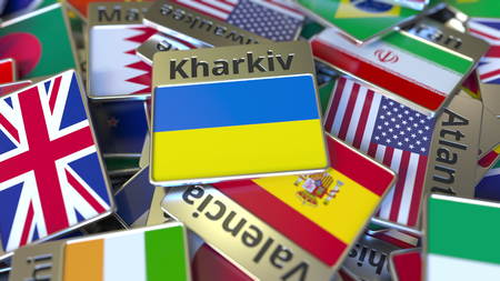 Souvenir magnet or badge with Kharkiv text and national flag among different ones. Traveling to Ukraine conceptual 3D rendering Stockfoto