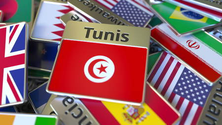Souvenir magnet or badge with Tunis text and national flag among different ones. Traveling to Tunisia conceptual 3D rendering