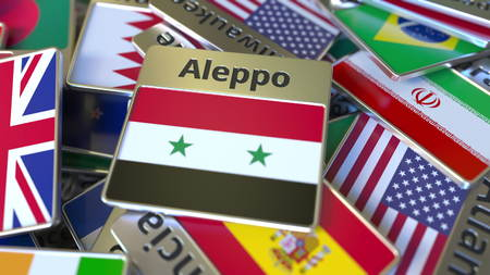 Souvenir magnet or badge with Aleppo text and national flag among different ones. Traveling to Syria conceptual 3D rendering Stockfoto