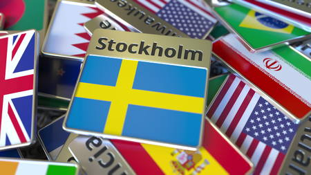 Souvenir magnet or badge with Stockholm text and national flag among different ones. Traveling to Sweden conceptual 3D rendering Stockfoto