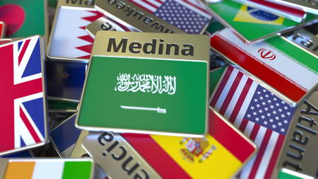 Souvenir magnet or badge with Medina text and national flag among different ones. Traveling to Saudi Arabia conceptual 3D rendering Stockfoto