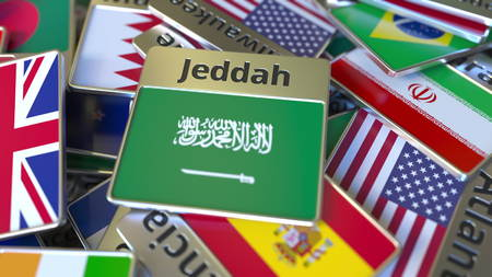 Souvenir magnet or badge with Jeddah text and national flag among different ones. Traveling to Saudi Arabia conceptual 3D rendering