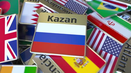 Souvenir magnet or badge with Kazan text and national flag among different ones. Traveling to Russia conceptual 3D rendering