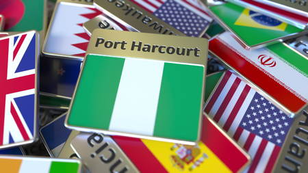 Souvenir magnet or badge with Port Harcourt text and national flag among different ones. Traveling to Nigeria conceptual 3D rendering