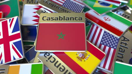 Souvenir magnet or badge with Casablanca text and national flag among different ones. Traveling to Morocco conceptual 3D rendering Stok Fotoğraf