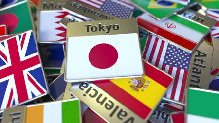 Souvenir magnet or badge with Tokyo text and national flag among different ones. Traveling to Japan conceptual 3D rendering