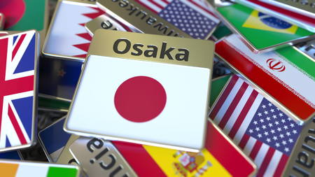 Souvenir magnet or badge with Osaka text and national flag among different ones. Traveling to Japan conceptual 3D rendering