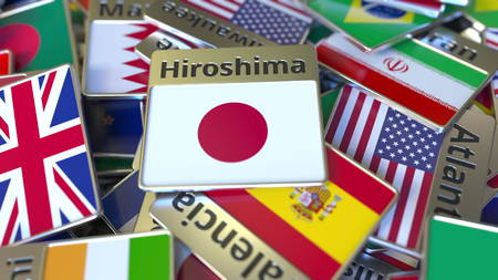 Souvenir magnet or badge with Hiroshima text and national flag among different ones. Traveling to Japan conceptual 3D rendering