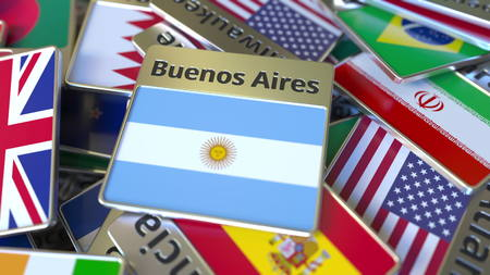Souvenir magnet or badge with Buenos Aires text and national flag among different ones. Traveling to Argentina conceptual 3D rendering