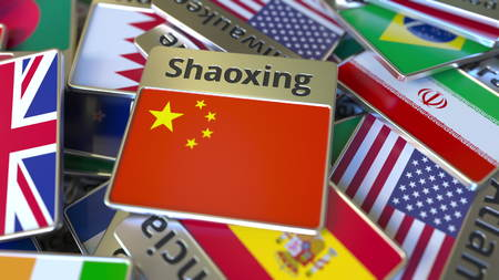 Souvenir magnet or badge with Shaoxing text and national flag among different ones. Traveling to China conceptual 3D rendering Stok Fotoğraf