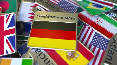 Souvenir magnet or badge with Frankfurt am Main text and national flag among different ones. Traveling to Germany conceptual 3D rendering Stockfoto