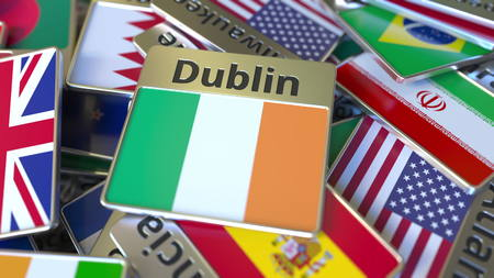 Souvenir magnet or badge with Dublin text and national flag among different ones. Traveling to Ireland conceptual 3D rendering Stockfoto